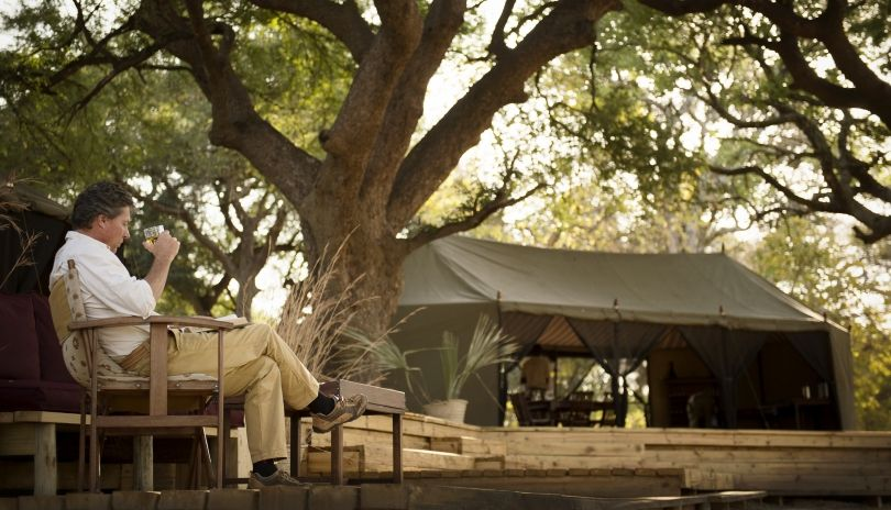 The heart of the camp at Chada Katavi, raised decks nestle under the tamarind trees overlooking the vast Chada plains.