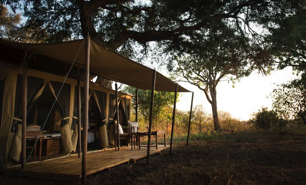 Six airy sleeping tents past which elephants and bushbuck often wander.