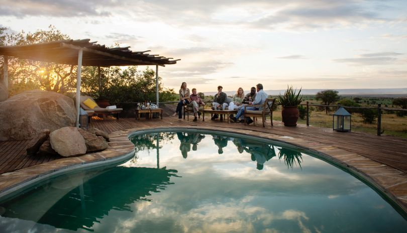 Poolside sunset from your private Serengeti home at Mkombe's House Lamai.