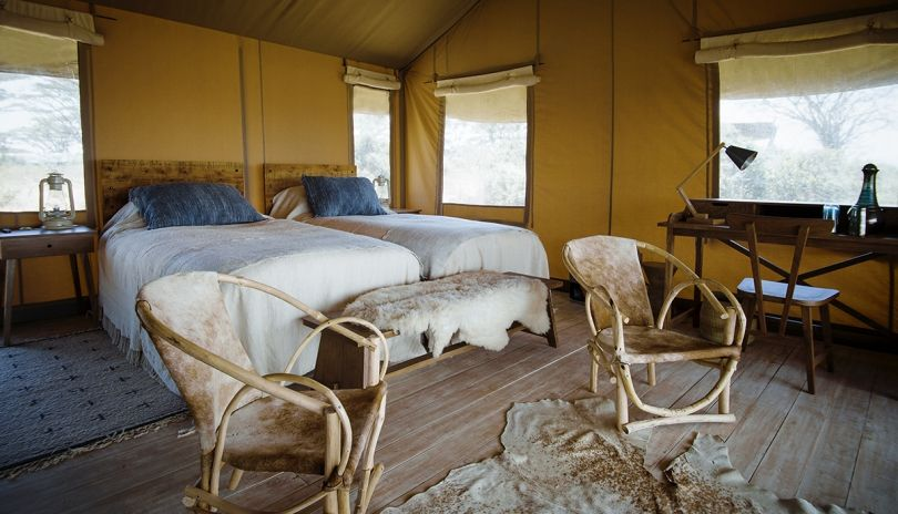 We have two family tents at Entamanu Ngorongoro which have two full size bedrooms and an adjoining shared bathroom.