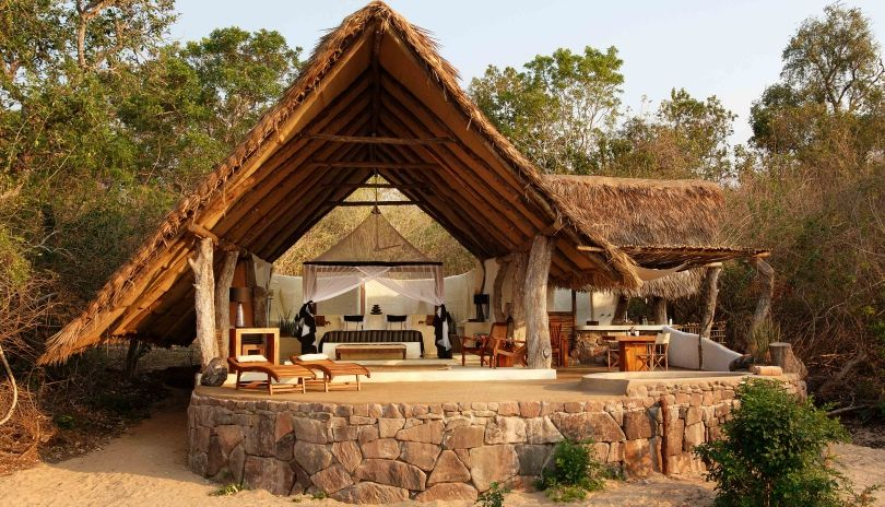 Four riverside open fronted suites at Kiba Point Selous.