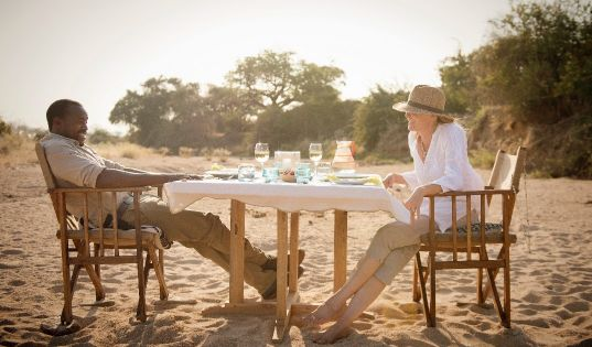 Dining with your feet in the sand of a dry riverbed. Why? Because you can.
