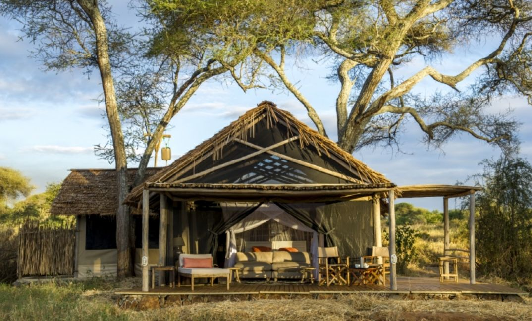 Large airy rooms at Kuro Tarangire, covered in thatch to keep you cool and with views out over the wilds of Tarangire.