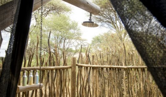 Traditional safari bucket showers inside, and outside at Kuro Tarangire.