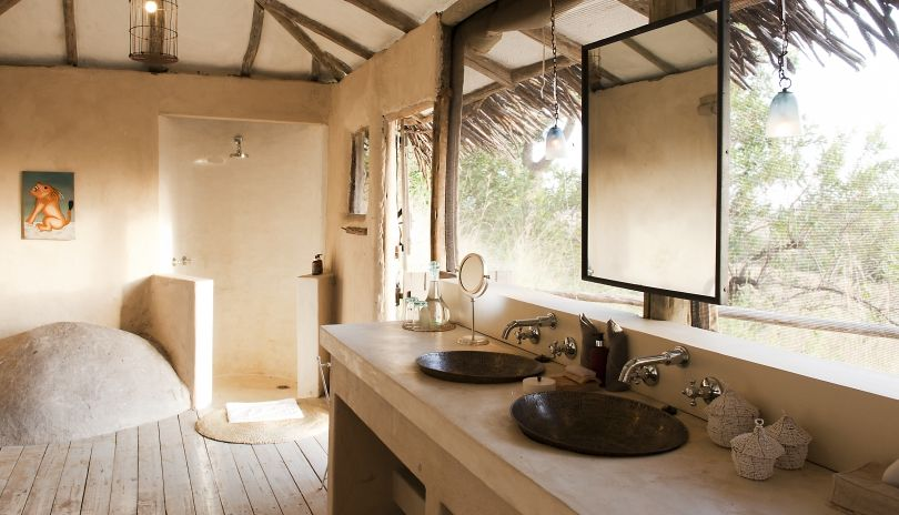 Light, airy en-suite bathrooms at Lamai Private still make the most of the incredible views over the Serengeti plains.