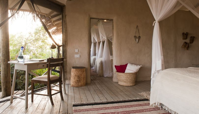The family room at Lamai Serengeti has an adjoining children's room and shared bathroom.