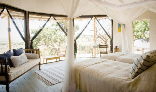Almost completely open fronted rooms at Lamai Serengeti make the most of our epic location.