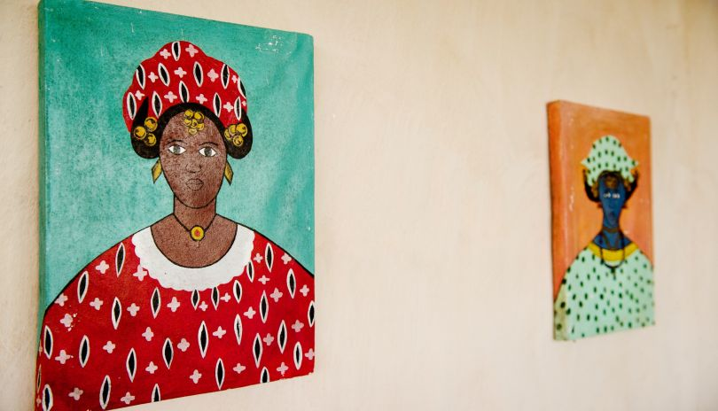 Local paintings from Tanzania decorate the walls at Lamai.