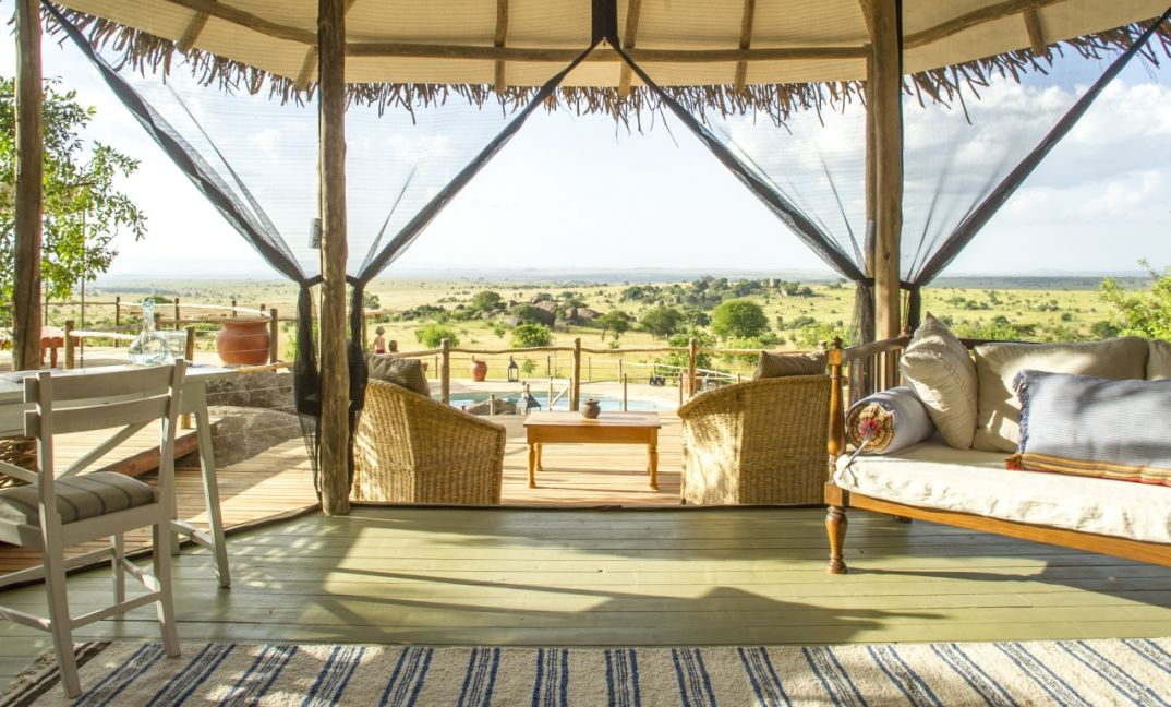 Open fronted bedrooms with endless views over the Northern Serengeti from  Mkombe's House Lamai.