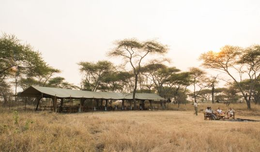 The central mess and fire place at Serengeti Safari Camp.