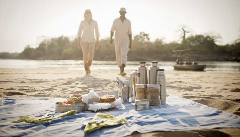 Stopping for breakfast on a sand bar while on a boat safari at Sand Rivers Selous.