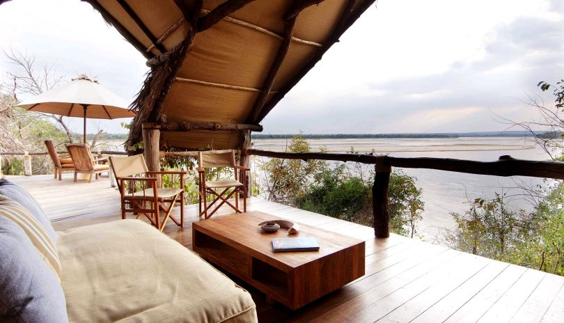 The mile wide Rufiji River flows past the open-fronted rooms at Sand Rivers Selous.