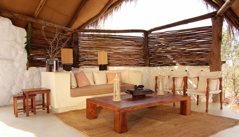 Each Hillside Suite at Sand Rivers Selous has its own adjoining living area.