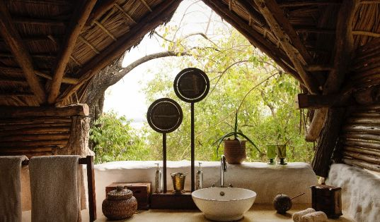 Being in the bush doesn't mean a lack of comfort. But it does mean you can have a bathroom with a view.