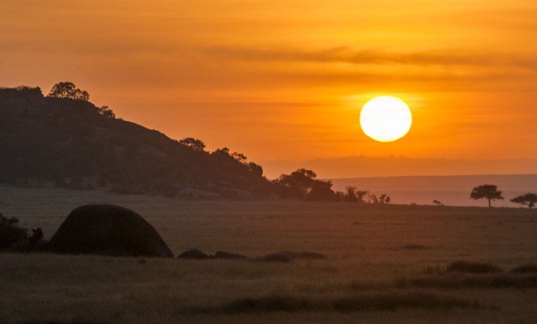 The drama of a sunset over the Serengeti.